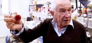 Elderly patient receives his prescription at Israeli pharmacy.