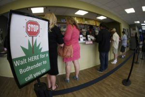 Consumers take advantage of lower prices at a Colorado dispensary.
