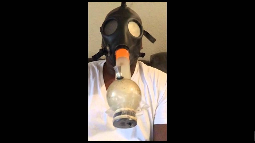 smoking and clearing acrylic gas mask water pipe